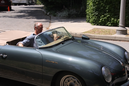 Xander Berkeley pulls up in the 58' Porsche Roadster