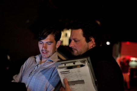 Producer Jonathan Lynch and AD Sebastian Bauer go over the schedule